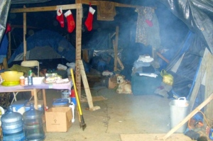 "This is a shot of a camp that ""housed"" several people in Nashville's Tent City that my wife and I visited one Christmas. Every month or two, someone's camp was burnt to the ground for one reason or another."